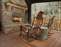 outside fireplace with deck chairs